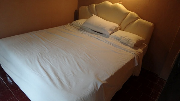 Travel sleep sheets on a king size bed